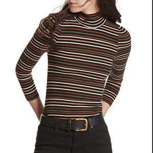Free people Im cute long sleeve knit top.